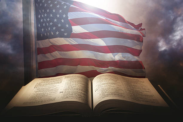 Holy Bible with the american flag stock photo