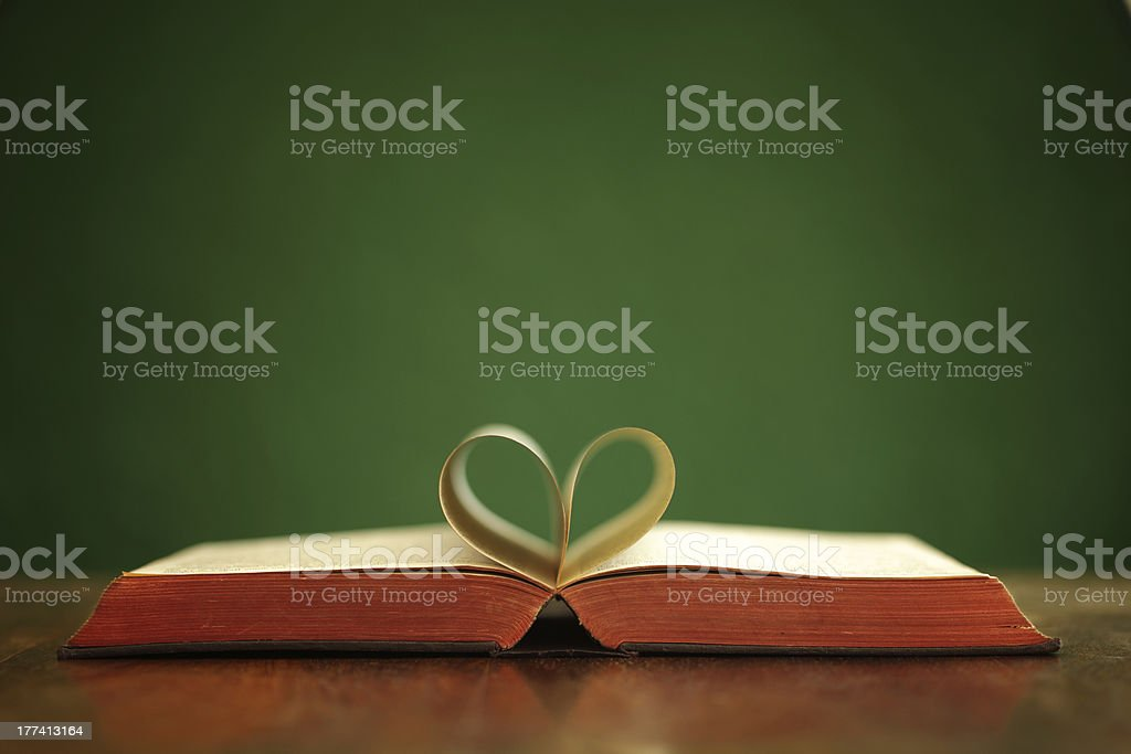 Holy bible with two pages folded into a heart stock photo