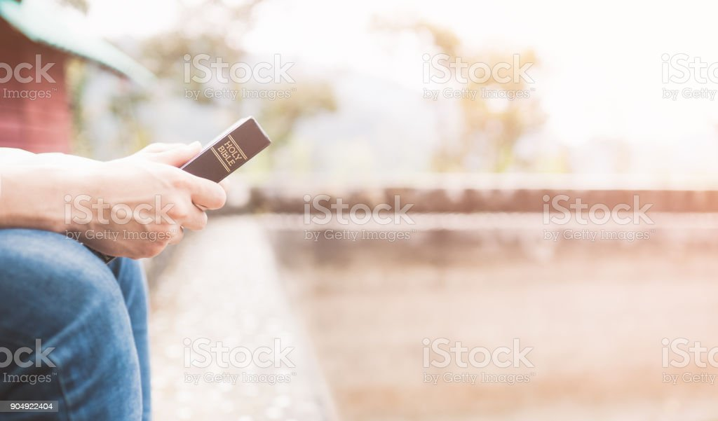 Holy bible,Teenager man holding Holy bible ready for read and have relationship with god faith, spirituality and religion concept. - foto stock