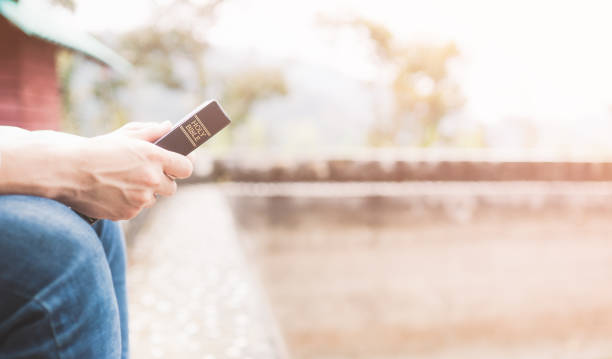 Holy bible,Teenager man holding Holy bible ready for read and have relationship with god faith, spirituality and religion concept. stock photo