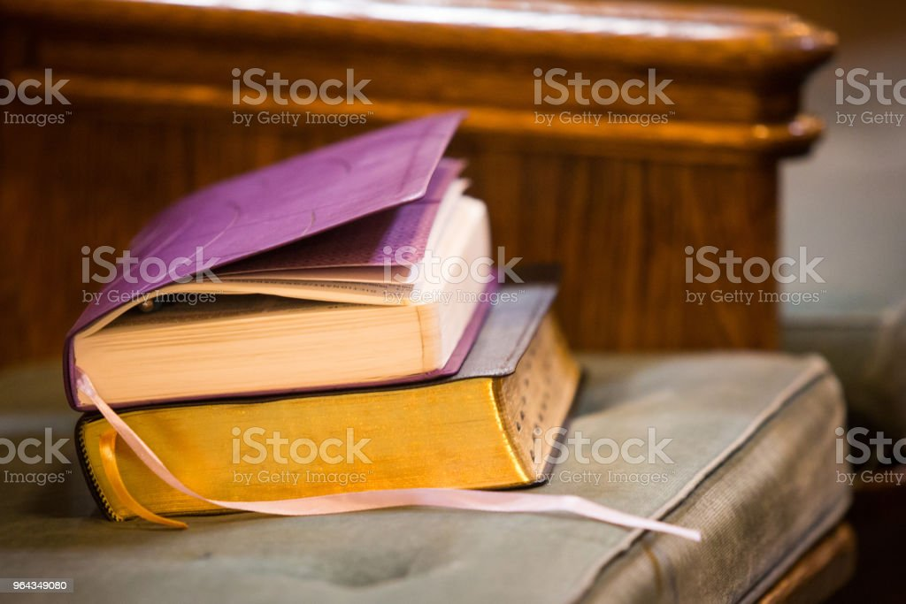 Holy books at church bench stock photo