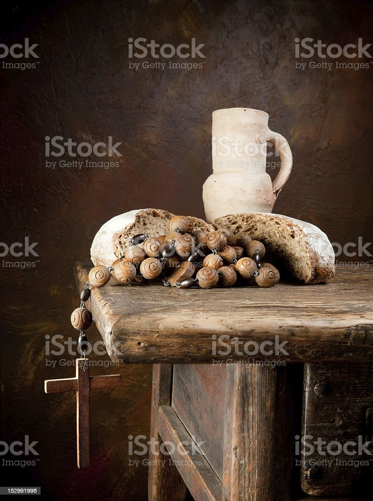 Holy bread and a rosary royalty-free stock photo