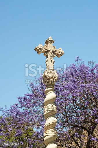 Holy Cross statue placed inside the Old Hospital building in Raval, Barcelona, Spain.