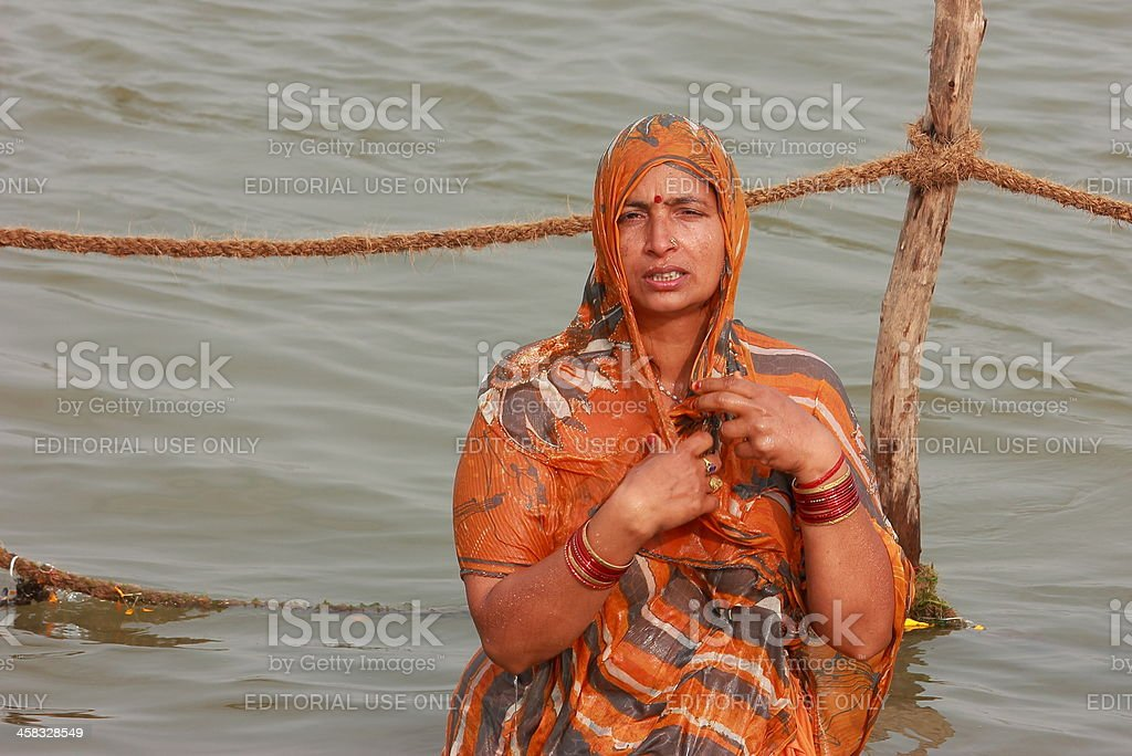 Holy dip - Lady in Kumbh 2013 royalty-free stock photo