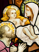 Compilation of  stained glasses showing Holy Family. Stained glass windows were created approximately in mid XIX century