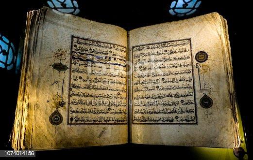 istock Holy islamic calligraphy in historical Koran(Quran) 1074014156