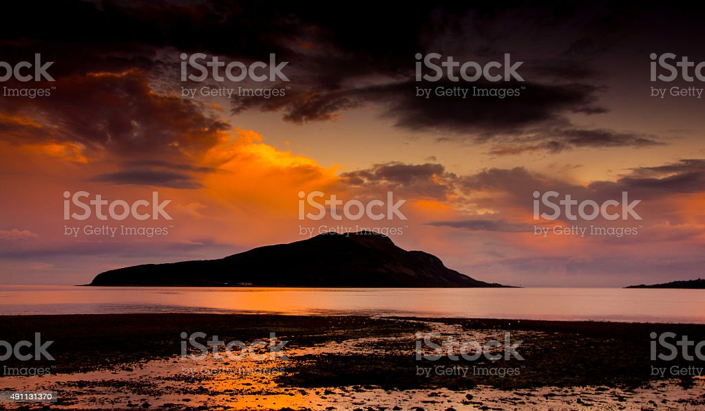 Holy Island, viewed at sunset from Lamlash, Arran, Scotland stock photo