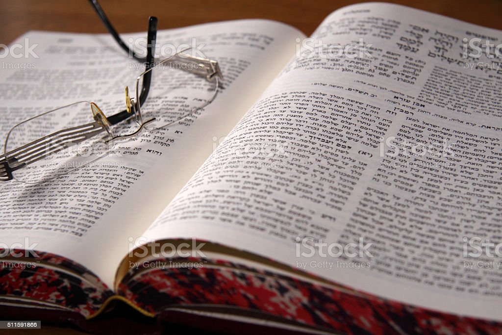 Holy Jewish book and glasses stock photo