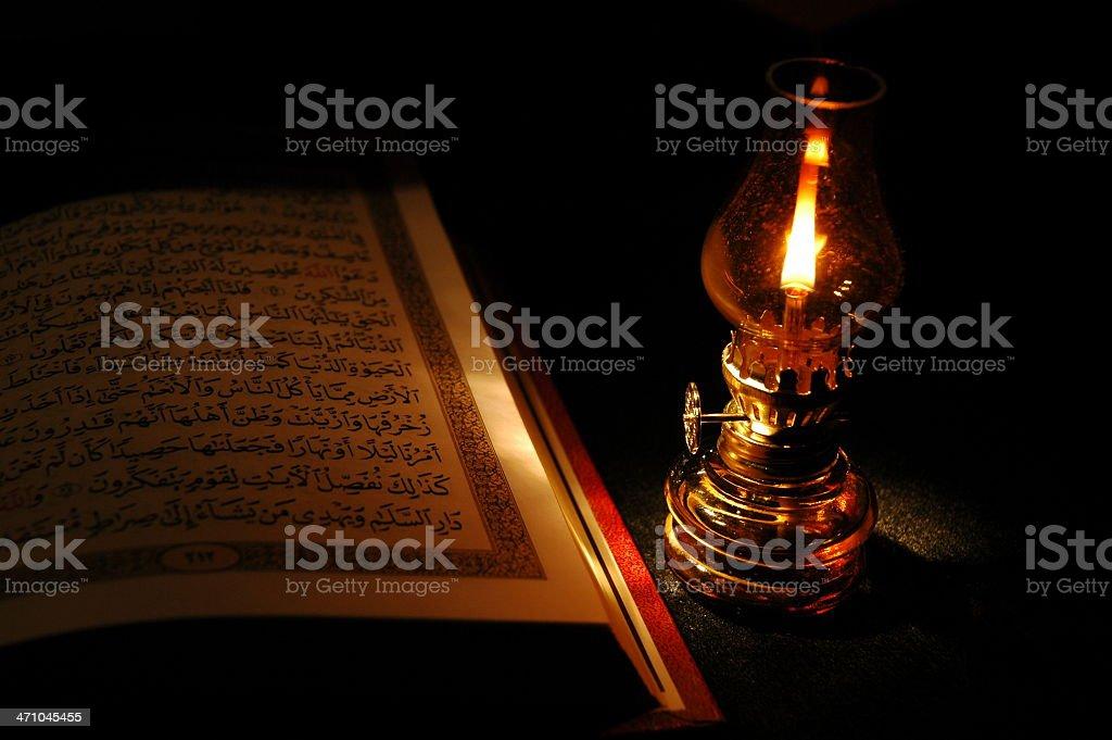 Holy Koran and a lantern stock photo