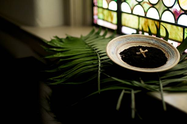 Holy Lent We prepare for the Lenten Season with the imposition of Ashes. The palm branches from last year during Holy Week are burned to prepare for this year's Ash Wednesday. lent stock pictures, royalty-free photos & images