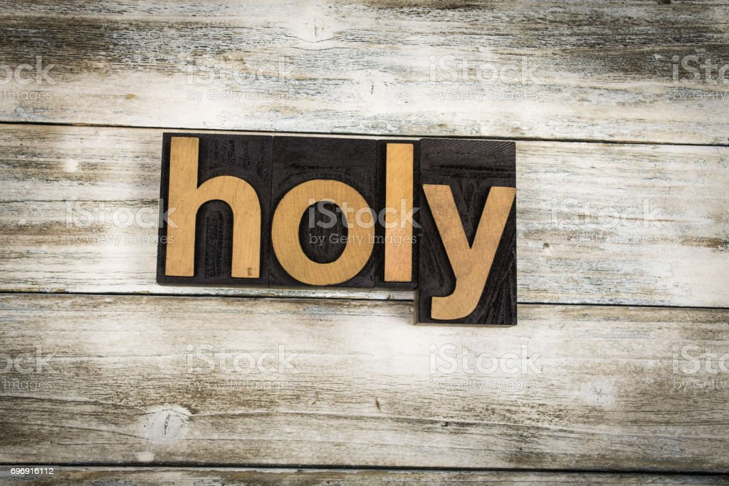 Holy Letterpress Word on Wooden Background stock photo