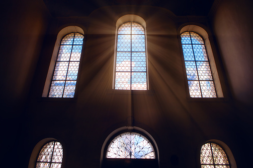 Holy light in the church window . Sun rays inside the place of worship