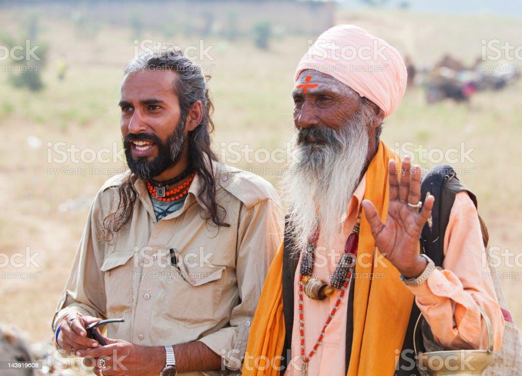 Holy man and young Indian at Pushkar camel fair, India. royalty-free stock photo
