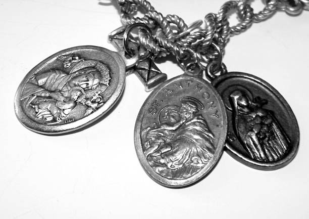 Holy Medals Three medals depicting the Virgin Mary, Saint Anthony and Saint Theresa  st. anthony of padua stock pictures, royalty-free photos & images