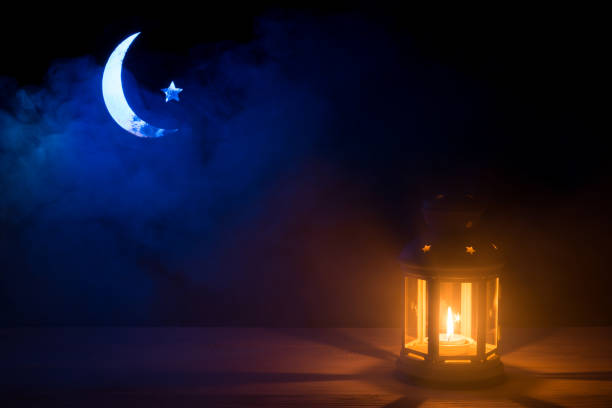 holy month of ramadan kareem. background with a shining lantern, crescent moon and star - ramadan stock photos and pictures