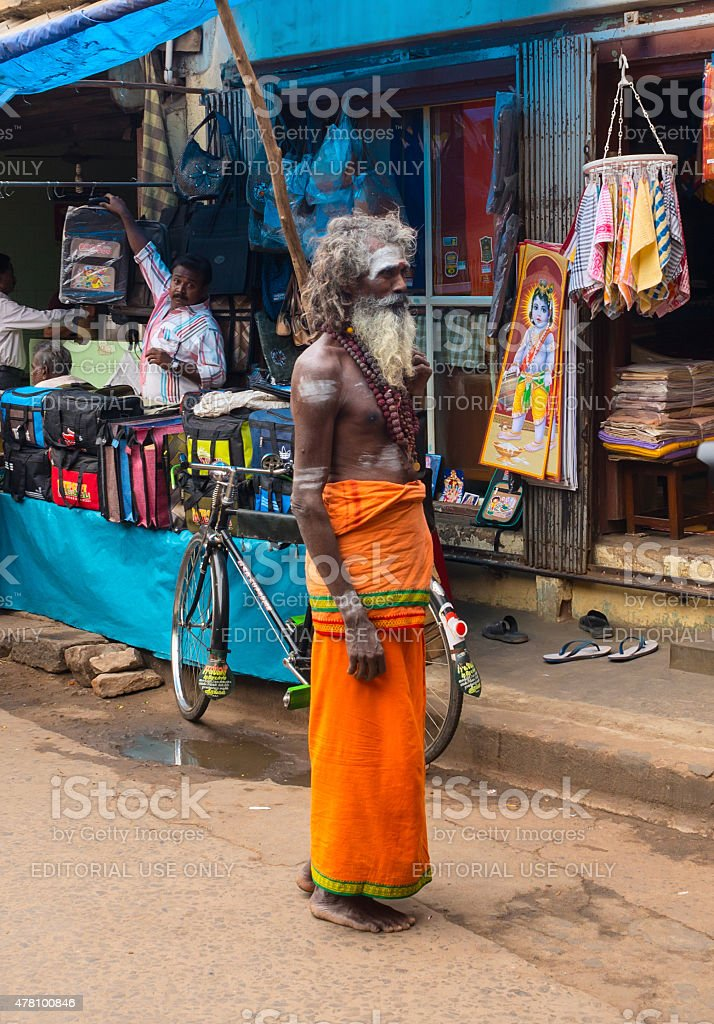 Holy Sadhu man with traditional painted face at street stock photo