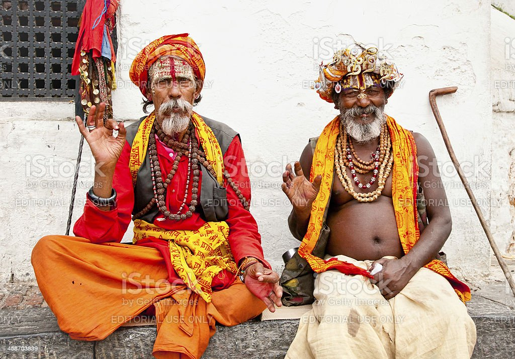 Holy Sadhu men with traditional painted face, blessing in Pashup stock photo