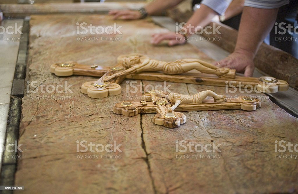 Holy Sepulcher Hands and crosses over a stone stock photo