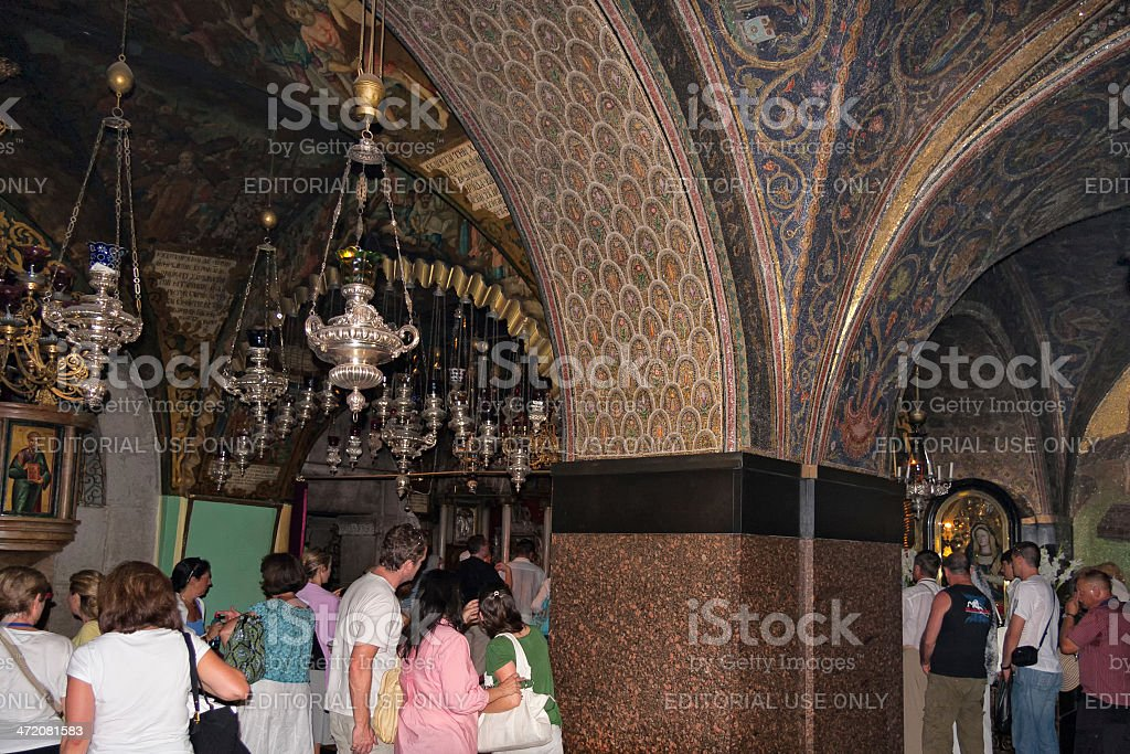 Holy Sepulchre church interior and pilgrims queue to Golgotha altar stock photo
