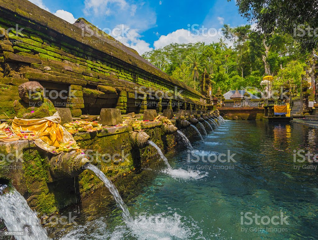 Holy spring water in Tirta Empul temple, Bali, Indonesia stock photo