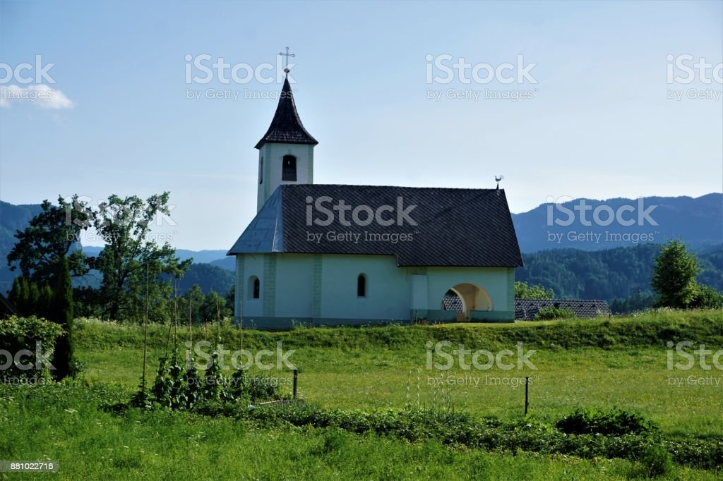 Holy Trinity Church and meadow in Zasip stock photo