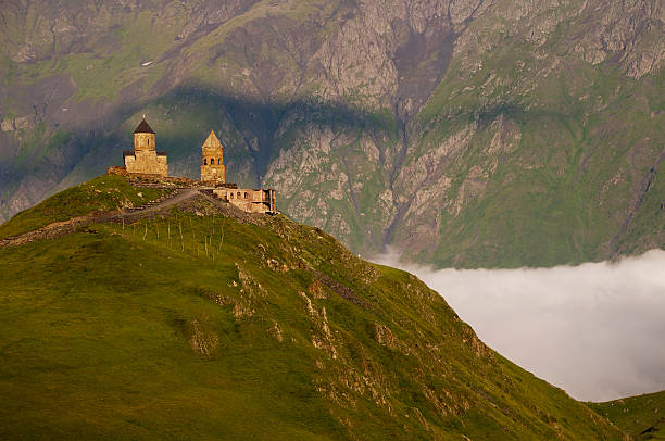 Holy Trinity Church near the villages of Gergeti, Georgia stock photo