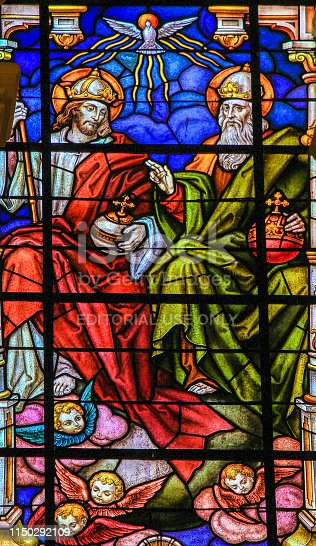 Stained glass depicting the Holy Trinity in the Cathedral of Malaga, Spain