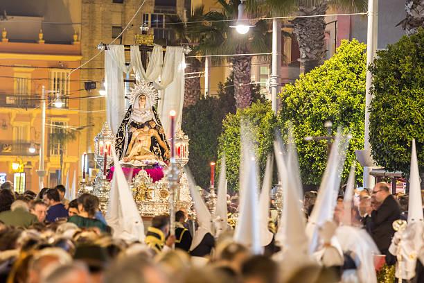holy week in san fernando, cadiz, spain. brotherhood of charity. - easter procession spain bildbanksfoton och bilder