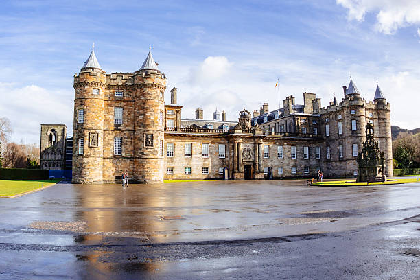 Holyrood Palace, Edinburgh Edinburgh, UK - March 8, 2015: Visitors outside Holyrood Palace in Edinburgh, Scotland. Officially known as The Palace of Holyroodhouse, it has been the official residence of the Scottish kings and queens since the 15th Century. theasis stock pictures, royalty-free photos & images