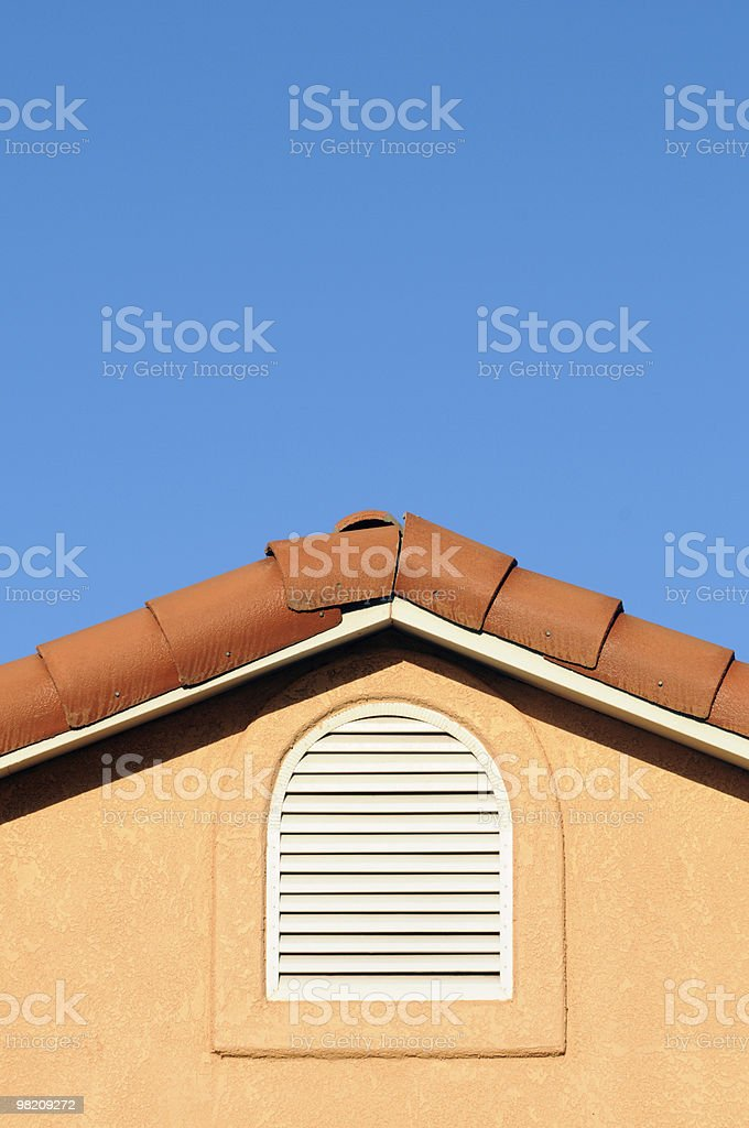 Home Adobe Rooftop and Blue Sky with Copy Space. royalty-free stock photo