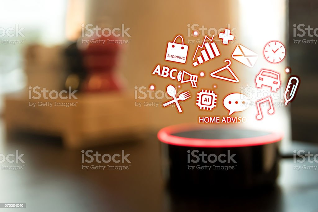 Home advisor , voice recognition , artificial intelligence device and internet of things concept. Technology icons and blur kitchen background. stock photo