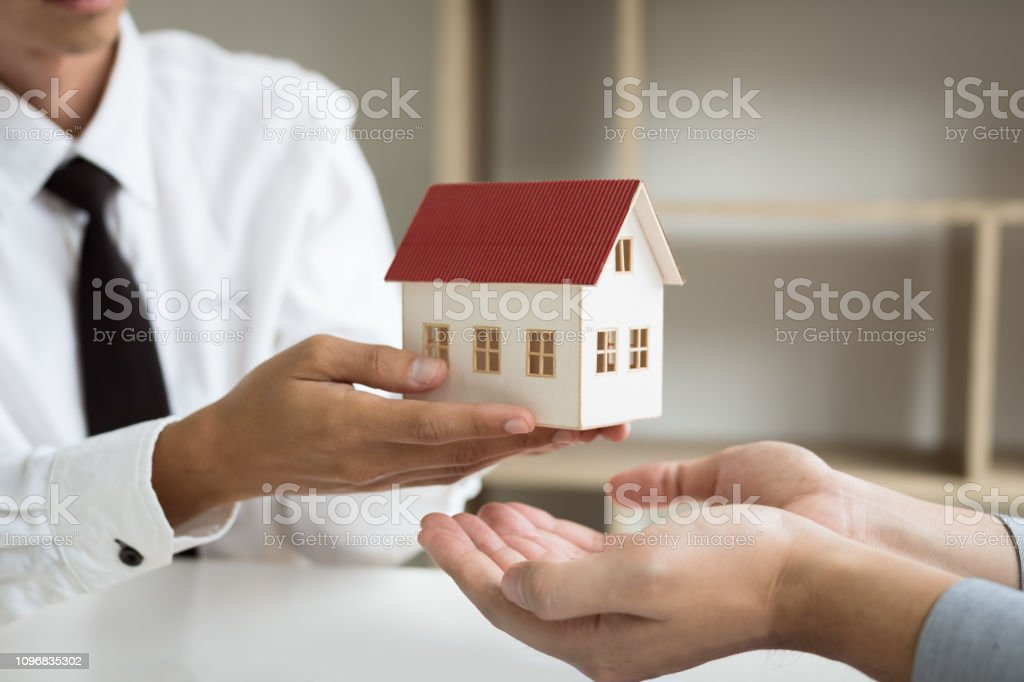 Home Agents Are Giving House Gifts To New Home Buyers In Office Room Stock Photo Download Image Now Istock
