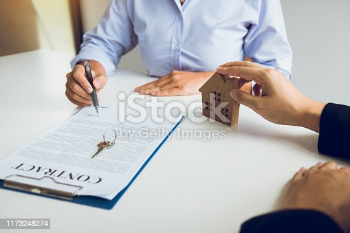 481337750istockphoto Home agents are sending pens to customers signing a contract to buy a new home. 1173248274