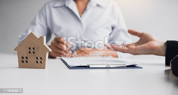 481337750istockphoto Home agents are sending pens to customers signing a contract to buy a new home. 1176463912