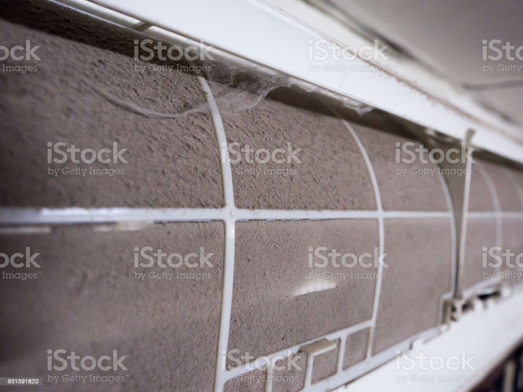 Home air conditioner's filter choke with fully of dust, dirty filter.  royalty-free