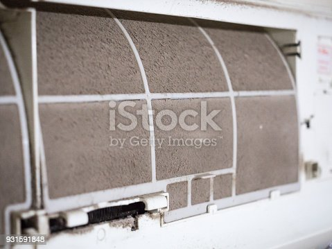 931591820 istock photo Home air conditioner's filter choke with fully of dust, dirty filter. 931591848