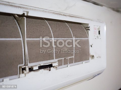 931591820 istock photo Home air conditioner's filter choke with fully of dust, dirty filter. 931591874