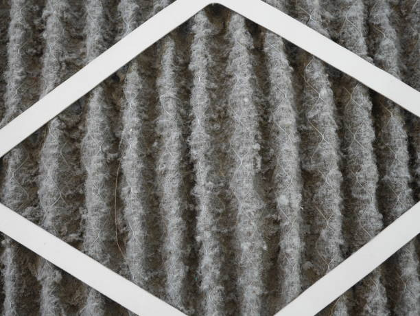 home air filter close up macro zoom show the dirt and particle cause bacteria inflection and sickness. - furnace stock photos and pictures