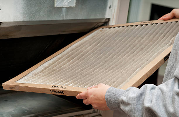 Home Air Filter Home owner changing their dirty air filter.   air filter stock pictures, royalty-free photos & images