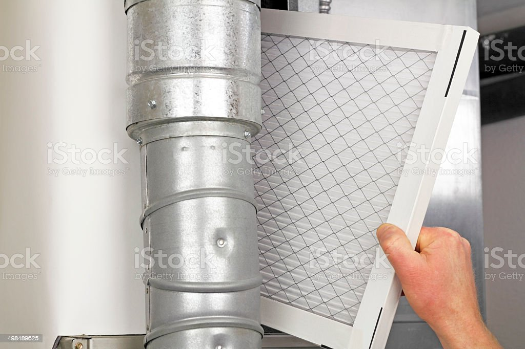 Home Air Filter Replacement - Royalty-free Adult Stock Photo