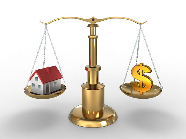 Home and Dollar on compared - clipping path included stock photo