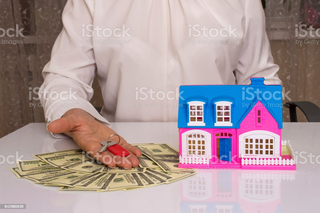 home and house key on a female hand stock photo