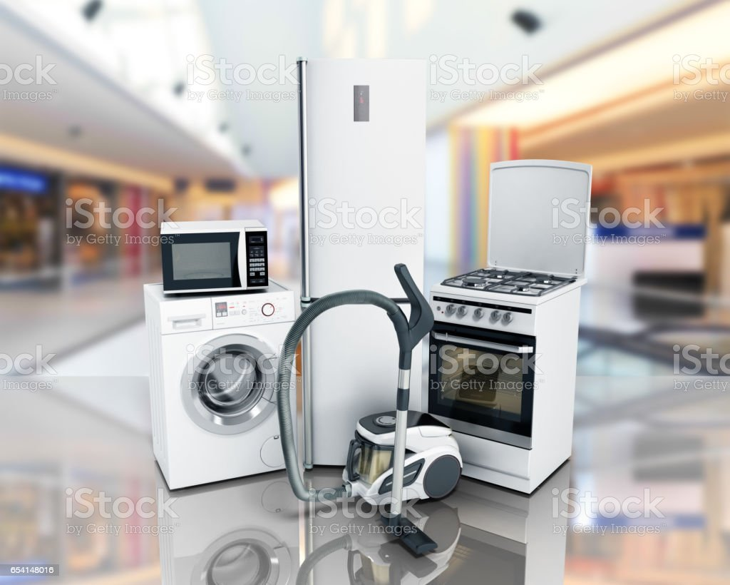 Home appliances Group of white refrigerator washing machine stove microwave stock photo