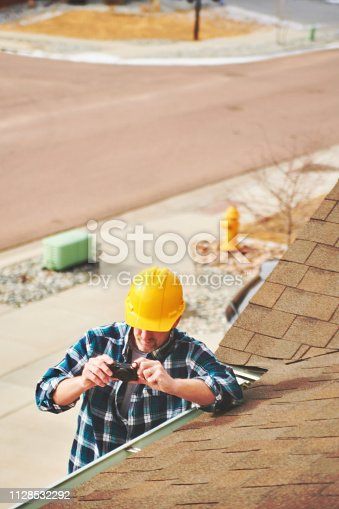 534196421istockphoto Home Appraiser or Home Inspector surveying roof of property 1128532292