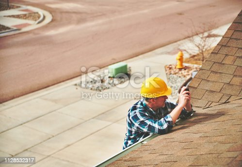 534196421istockphoto Home Appraiser or Home Inspector surveying roof of property 1128532317