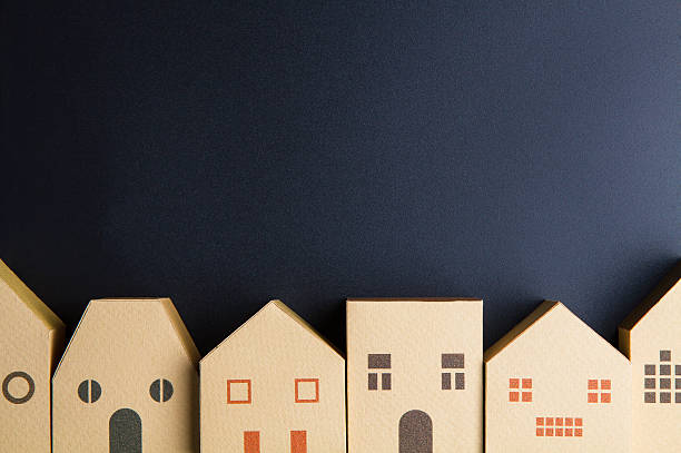 Home architectural model paper box cubes on black background – Foto