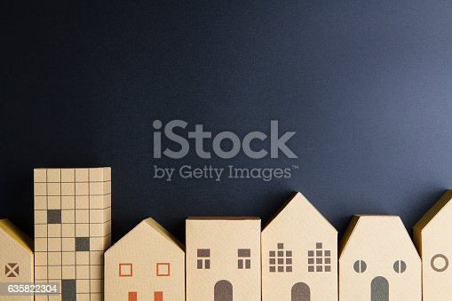 istock Home architectural model paper box cubes on black background 635822304
