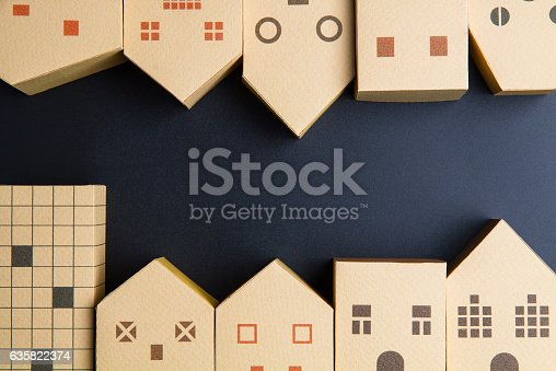 istock Home architectural model paper box cubes on black background 635822374