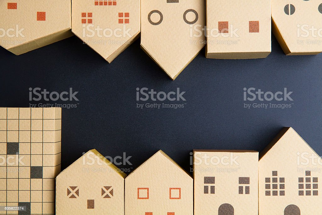 Home architectural model paper box cubes on black background stock photo