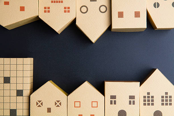 Home architectural model paper box cubes on black background - Photo